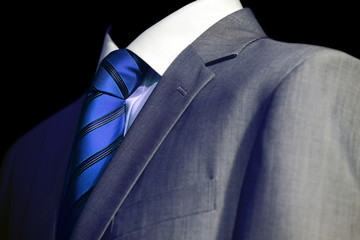 Elegant mysterious businessman in a dark glow