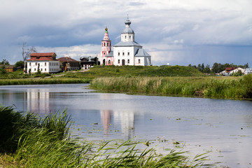 White church on a riverbank