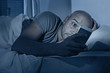 internet addict man awake at night in bed with mobile phone - 71781049