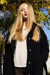 Pretty girl is wearing winter black coat