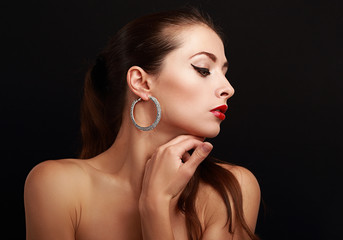 Beautiful makeup woman face profile in fashion earrings