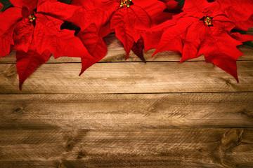 Hintergrund aus Holz und Weihnachtsstern