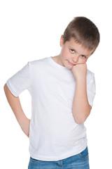 Thoughtful boy in a white shirt