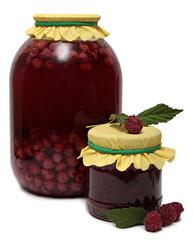 Glass jar of stewed fruit, jam and fresh raspberries. Shot in