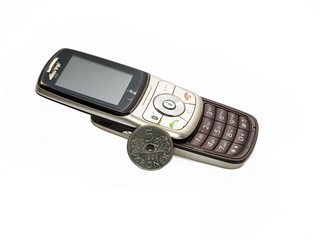 Old cell phone ruined and scratchy and norwegian currency