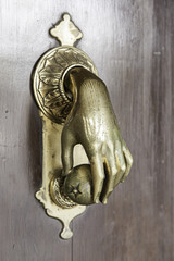 Door knocker in the shape of hand