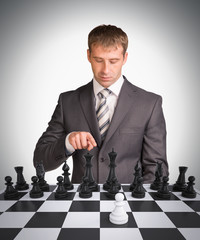 Businessman and chess board
