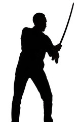 Silhouette of young man with sword