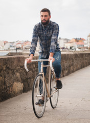 Hipster man riding in  a fixie bike
