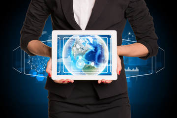 Businesswoman using tablet pc. Image of Earth on screen