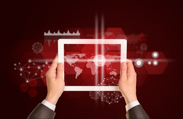 Man hands using tablet pc. Image of world map on screen