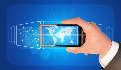 Man hand holding smart phone. Image of world map on screen