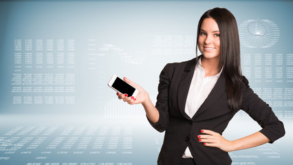 Businesswoman holding smart phone and smiling
