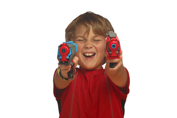 Young boy holding up two toy guns, isolated over white