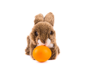 Easter rabbit toy with orange egg isolated