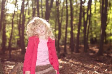 blond girl in red coat