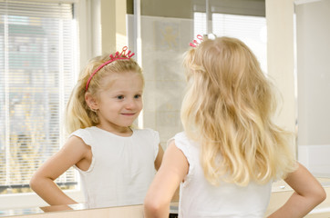 blond girl in mirror