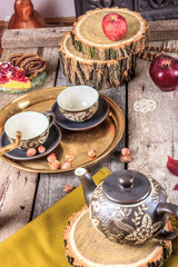 Romantic composition of cups and cookies on wooden table