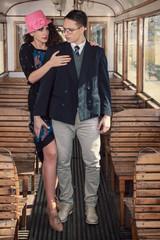 vintage style couple inside retro train coach have an argument a