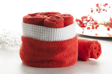 rolled up red towels