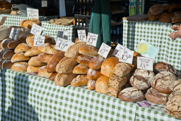 Freshly baked loaves of bread on a market stall