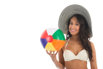 Black woman playing with beach ball
