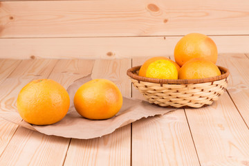 Grapefruits on a wooden background
