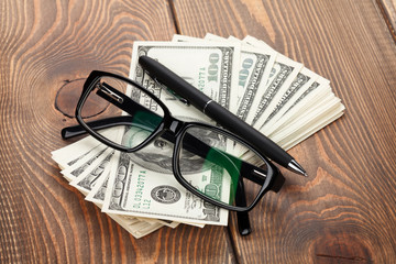 Money, glasses and pen