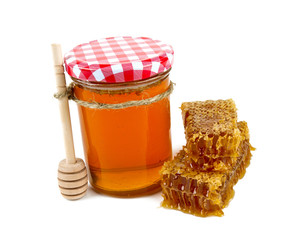fresh honey and honeycomb isolated on white