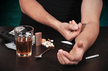 addict takes drugs