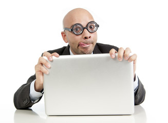 funny geek bald businessman with computer looking nerdy