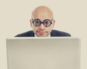 funny geek nerd businessman with computer laptop