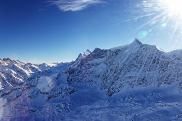 Jungfrau highland with ice flow in winter helicopter view