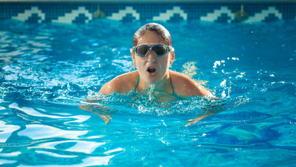 young swimmer woman taking a breath at swimming pool
