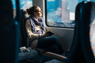 Woman reading ebook on train