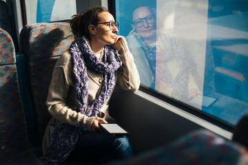 Woman reading ebook on train bus