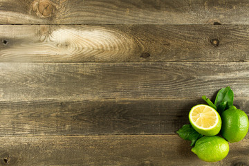 Wood background with limes