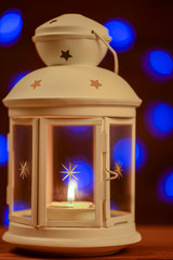 Christmas lantern with burning candle background