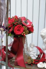 Red wedding bouquet in the flower shop