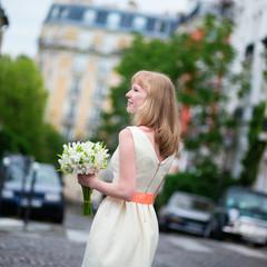 Beautiful bride on a street ofMontmartre in Paris