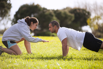 Couple exercising at the park