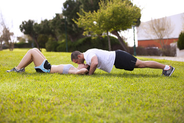 Couple making exercise and kissing