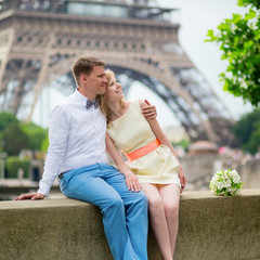 Just married couple hugging near the Eiffel tower