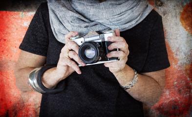 Retro camera in girl's hands