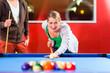 Couple playing pool billiard game