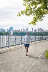 Jogger enjoys Central Park on a cool day