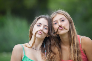 playful teens with hair moustache