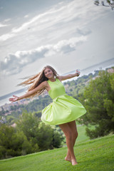 carefree woman dancing in summer