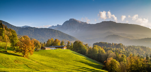 Beautiful autumn landscape with farm house in the Alps