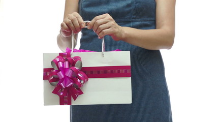 Female Torso Holding Pink Gift Bag